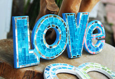 Mosaic letters forming word LOVE. Shallow depth of field Royalty Free Stock Photos