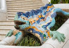 Mosaic lizard in park Guell, Barcelona. Mosaic Lizard made from broken ceramic tiles in Park Guell designed by Antoni Gaudi considered as a symbol of the park Royalty Free Stock Photos