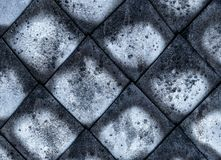 Mosaic lozenge cement gray canvas weathered old, part of the roof surface damaged by sediments dark pattern royalty free stock photography