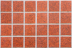Mosaic made of red ceramic tiles in form of squares in rectangular form Royalty Free Stock Images