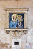 Mosaic of the Madonna at a house wall in Pisa Stock Photo