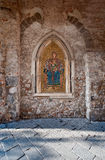 Mosaic of Madonna in Taormina. Old byzantine mosaic in Taormina. This mosaic is embedded in a wall in a covered archway in Corso Umberto Stock Photo
