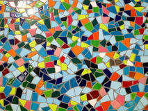 Mosaic in many colours and shapes. On the wall of a bathroom Stock Photos