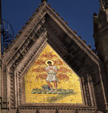 Mosaic mural on church facade Stock Photo