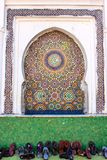Mosaic niche in a mosque in the foreground deferred shoes, Stock Photos