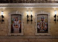 Mosaic painting of a man and a woman dressed in traditional Moldovan costumes royalty free stock images