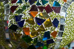 Mosaic pattern made of colorful fragments of glass. In view royalty free stock images