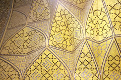 Mosaic pattern on wall. Abstract background of mosaic pattern on angular yellow wall royalty free stock photos