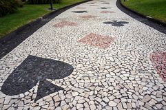 Mosaic paving tile of footpath in Funchal, Madeira, Portugal. Royalty Free Stock Photo