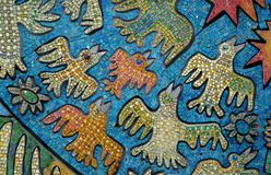 Mosaic picture with birds. Mosaic picture with funny birds in blue sky on the walll in Kiev's Palace of Congresses Stock Photos