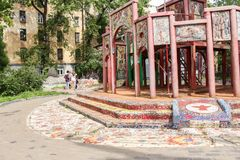 Mosaic on the playground. Freely accessible for examination of the exposition of mosaic art in the courtyard of residential buildings Royalty Free Stock Photography