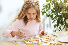 Mosaic puzzle art for kids, children`s creative game. two sisters are playing mosaic. The mosaic puzzle art for kids, children`s creative game. The hands are Stock Photos