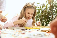 Mosaic puzzle art for kids, children`s creative game. two sisters are playing mosaic. The mosaic puzzle art for kids, children`s creative game. The hands are Royalty Free Stock Images