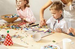 Mosaic puzzle art for kids, children`s creative game. two sisters are playing mosaic. The mosaic puzzle art for kids, children`s creative game. The hands are Stock Image