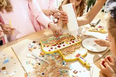 Mosaic puzzle art for kids, children`s creative game. The mosaic puzzle art for kids, children`s creative game. The hands are playing mosaic at table. Colorful Stock Images