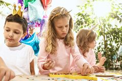 Mosaic puzzle art for kids, children`s creative game. The mosaic puzzle art for kids, children`s creative game. The hands are playing mosaic at table. Colorful Royalty Free Stock Image