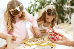 Mosaic puzzle art for kids, children`s creative game. two girls are playing mosaic. The mosaic puzzle art for kids, children`s creative game. The hands are Royalty Free Stock Image