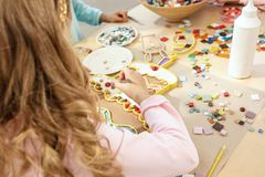 Mosaic puzzle art for kids, children`s creative game. two sisters are playing mosaic. The mosaic puzzle art for kids, children`s creative game. The hands are Royalty Free Stock Photos