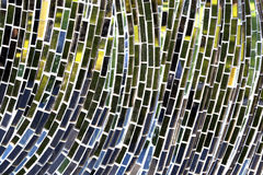 Mosaic reflection closeup. Mosaic mirror close up background with a twist reflecting green, blue and yellow shades as a background. With space for text Royalty Free Stock Image