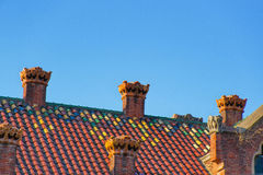 Mosaic roof of Hospital de Sant Pau in Barcelona. In Spain. In English it is called as Hospital of the Holy Cross and Saint Paul. It used to be a hospital. Now Royalty Free Stock Photo