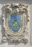 Mosaic shield of renowned port city Montevideo at the facade of United States Lines-Panama Pacific Lines Building. NEW YORK - AUGUST 6: Mosaic shield of renowned Stock Photos