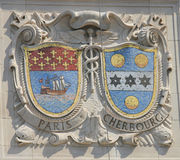 Mosaic shields of renowned port cities Paris and Cherbourg  at the facade of United States Lines-Panama Pacific Lines Building Stock Photo