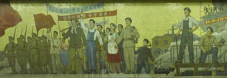 Mosaic in Pyongyang metro station, North Korea. Mosaic showing typical Northkorean style propaganda art in underground metro station in Pyongyang, Democratic Royalty Free Stock Image
