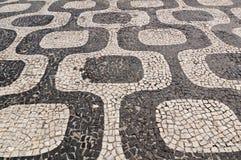 Mosaic of sidewalk Ipanema in Rio de Janeiro Stock Photos