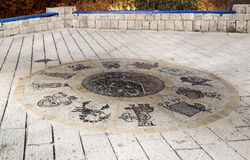 Mosaic with signs of the zodiac near the Wishing Bridge at night in old city Yafo, Israel. stock photography