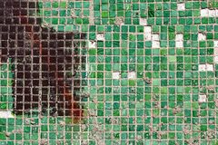 Mosaic of small square tiles. Mosaic of green small square tiles royalty free stock photo