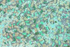 Mosaic stone wall of multi-colored polygons royalty free stock photo