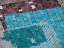 Mosaic stones. Mosaic blue and brown stones royalty free stock images