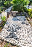 Mosaic of stones in the form of fish in the yard of the Beatitude Monastery located on the mountain on the coast of the Sea of Gal. Tiberias, Israel, September stock image
