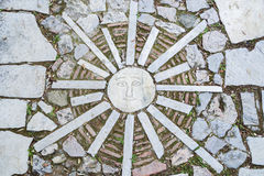 Mosaic, stylized sun in Athens, Greece. Stock Photos