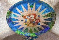 Mosaic sun Barcelona Gaudi. Mosaic sun medallion at the Parc Guell designed by Antoni Gaudi located on Carmel Hill, Barcelona, Spain stock photo