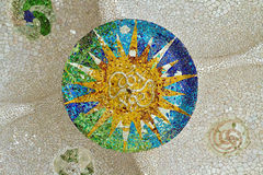 Mosaic sun at Guell Park royalty free stock images