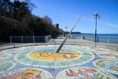 Mosaic sundial with zodiac signs. SVETLOGORSK, RUSSIA - APRIL 1: Mosaic sundial at the foot of the stairs on the boardwalk, with a diameter of 10 meters with 12 Royalty Free Stock Photography