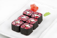The mosaic sushi roll with tuna and tobico. The mosaic sushi roll with tuna and tobico on the plate Stock Images