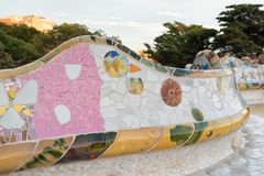 Mosaic tile bench in park Guell, Barcelona. Colorful abstract mosaic tile bench in Guell park in Barcelona, architectural details Stock Photography