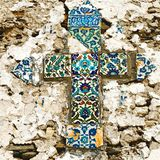 Mosaic tiled cross. Old mosaic tiled religious cross Royalty Free Stock Images