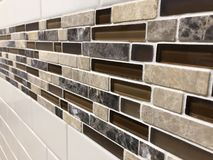 Mosaic tiles made of glass and stone, newly installed on the wall as decoration or kitchen backsplash. Tiles made of glass installed on the wall as decoration or royalty free stock photo