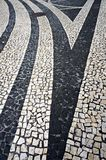 Mosaic tiles pavement in Funchal, Madeira, Portugal. Stock Photo
