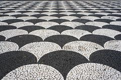 Mosaic tiles pavement in Funchal, Madeira, Portugal. Royalty Free Stock Images