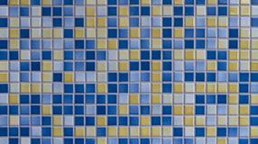 Mosaic tiles texture background. Blue and yellow mosaic tiles texture background royalty free stock photos