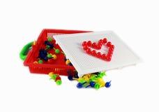 Mosaic toy. On white background Stock Photo