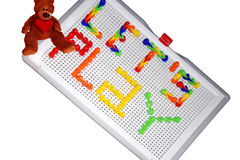 Mosaic toy with Teddy bear Stock Photo