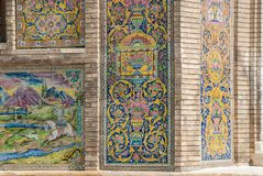 Mosaic traditional floral wall and old door. Mosaic traditional oriental floral wall pattern in Iran royalty free stock photo