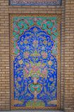 Mosaic traditional floral wall and old door. Mosaic traditional oriental floral wall pattern in Iran stock image