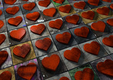 Mosaic of Valentine hearts made from red wood on multi-colored p Stock Photo