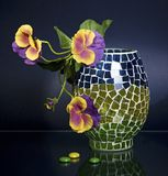 Mosaic vase and pansy on blue Royalty Free Stock Images